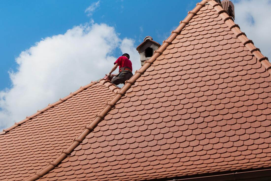Our roofers repairing the roof